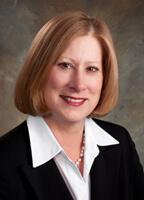 Carole Holland,  Washington Health Benefit Exchange Interim CFO, source: LinkedIn